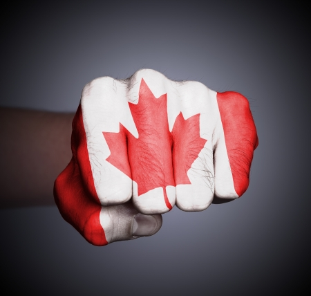 Front view of punching fist on gray background, flag of Canada