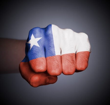 Front view of punching fist on gray background, flag of Chile Stock Photo - 17387831
