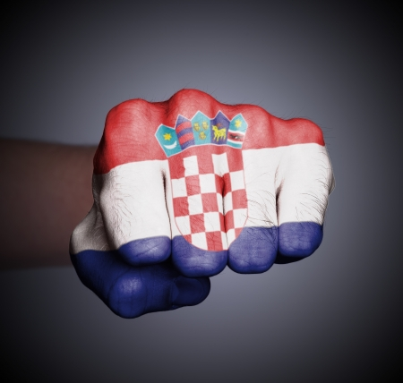 Front view of punching fist on gray background, flag of Croatia Stock Photo - 17387829