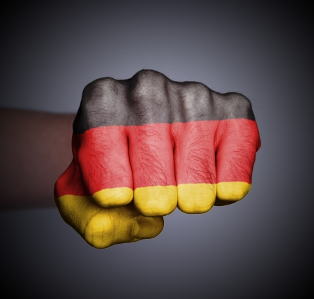 Front view of punching fist on gray background, flag of Germany Stock Photo - 17387804