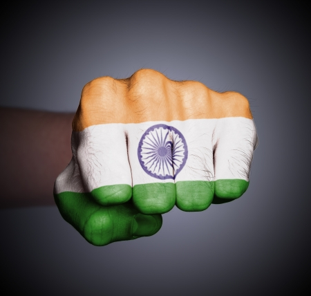 Front view of punching fist on gray background, flag of India Stock Photo - 17387826