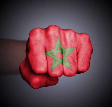 Front view of punching fist on gray background, flag of Morocco Stock Photo - 17387800