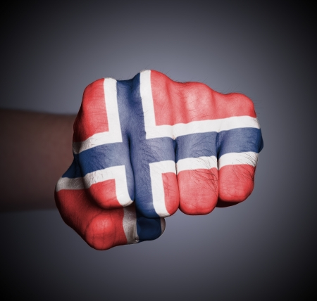 Front view of punching fist on gray background, flag of Norway
