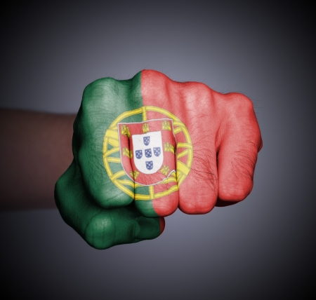 Front view of punching fist on gray background, flag of Portugal Stock Photo - 17387795