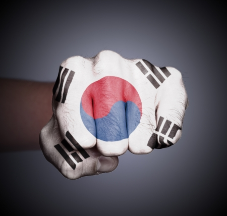 Front view of punching fist on gray background, flag of South Korea Stock Photo - 17387828