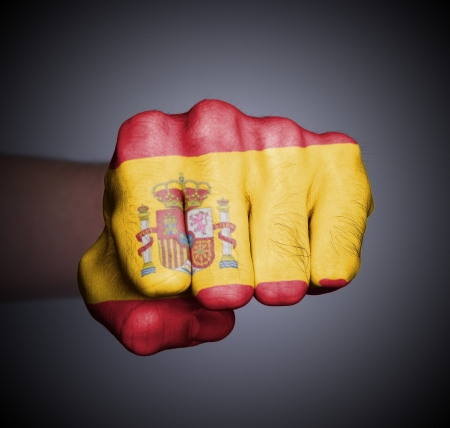 Front view of punching fist on gray background, flag of Stock Photo - 17387810
