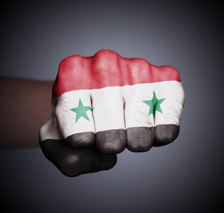 syrian war: Front view of punching fist on gray background, flag of Syria