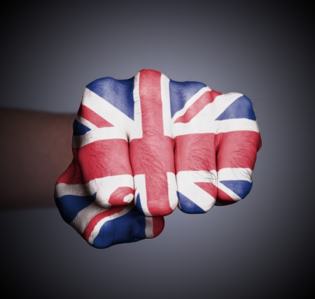 Front view of punching fist on gray background, flag of the UK photo