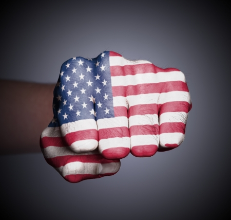 Front view of punching fist on gray background, flag of the USA