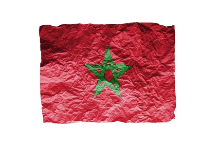 Close up of a curled paper on white background, print of the flag of Morocco photo
