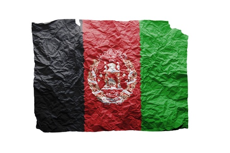 Close up of a curled paper on white background, print of the flag of Afghanistan photo