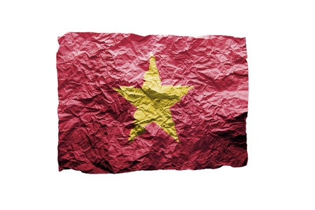 Close up of a curled paper on white background, print of the flag of Vietnam photo