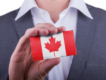 matte: Businessman showing card, matte paper effect, Canada Stock Photo