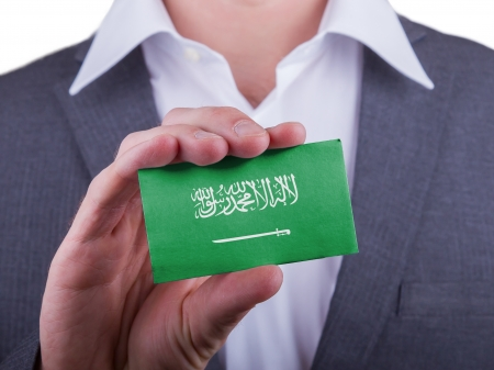 matte: Businessman showing card, matte paper effect, Saudi Arabia