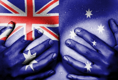Sweaty upper part of female body, hands covering breasts, flag of Australia