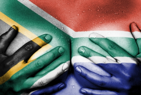 Sweaty upper part of female body, hands covering breasts, flag of South Africa