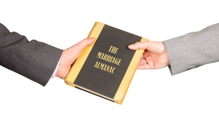 Man and woman holding a marriage almanac, saving her marriage Stock Photo - 17520214