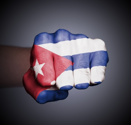 Front view of punching fist on gray background, flag of Cuba