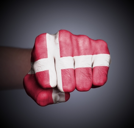 Front view of punching fist on gray background, flag of Denmark