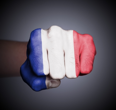 francaise: Front view of punching fist on gray background, flag of France