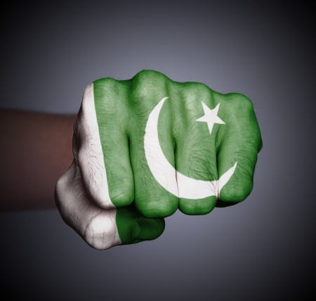 Front view of punching fist on gray background, flag of Pakistan