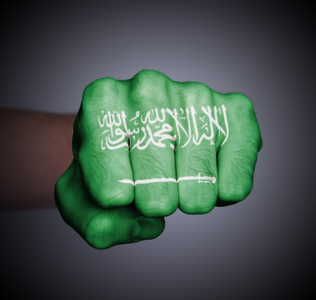 Front view of punching fist on gray background, flag of Saudi Arabia photo