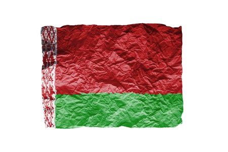 Close up of a curled paper on white background, print of the flag of Belarus photo