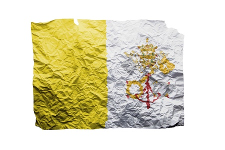 clipart wrinkles: Close up of a curled paper on white background, print of the flag of the Vatican
