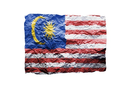 Close up of a curled paper on white background, print of the flag of Malaysia photo