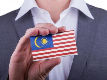 matte: Businessman showing card, matte paper effect, Malaysia