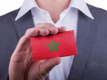 matte: Businessman showing card, matte paper effect, Morocco Stock Photo