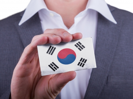 matte: Businessman showing card, matte paper effect, South Korea Stock Photo