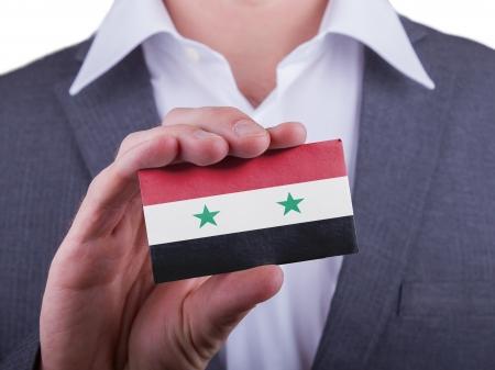 matte: Businessman showing card, matte paper effect, Syria