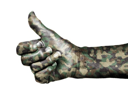 Old woman with arthritis giving the thumbs up sign, isolated on white, camouflage photo