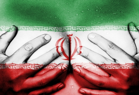 naked youth: Sweaty upper part of female body, hands covering breasts, flag of Iran Stock Photo