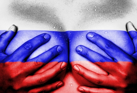 naked youth: Sweaty upper part of female body, hands covering breasts, flag of Russia