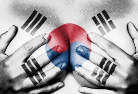 nudity young: Sweaty upper part of female body, hands covering breasts, flag of South Korea