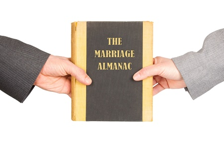 almanac: Man and woman holding a marriage almanac, saving her marriage