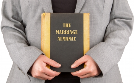 almanac: Woman holding a marriage almanac, saving her marriage