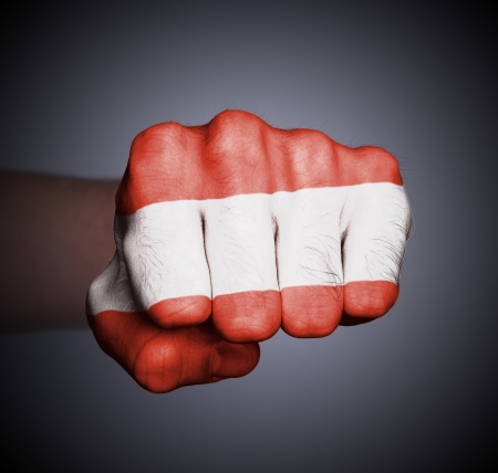 Front view of punching fist on gray background, flag of Austria Banco de Imagens