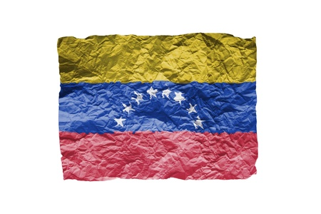 Close up of a curled paper on white background, print of the flag of Venezuela photo