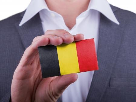 matte: Businessman showing card, matte paper effect, Belgium Stock Photo
