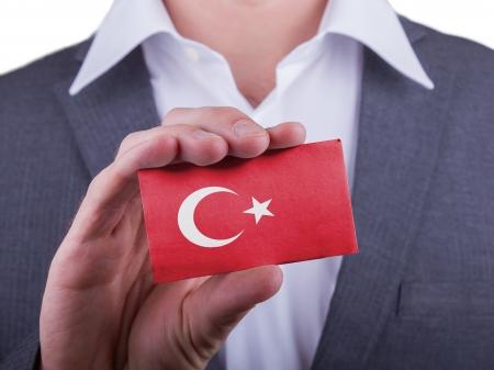 matte: Businessman showing card, matte paper effect, Turkey