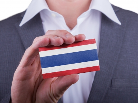 matte: Businessman showing card, matte paper effect, Thailand Stock Photo