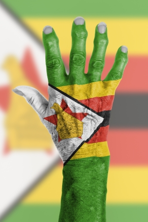 clipart wrinkles: Hand of an old woman wrapped in flag of Zimbabwe