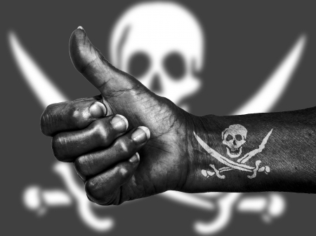 Old woman with arthritis giving the thumbs up sign, isolated on white, Pirate photo