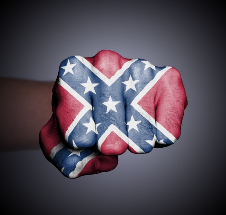 Front view of a punching hand, Confederate flag photo