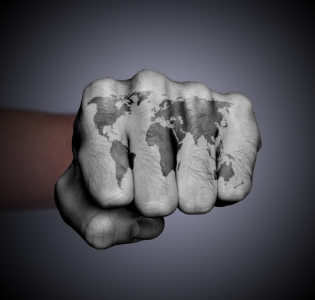 Front view of a punching hand, world map photo