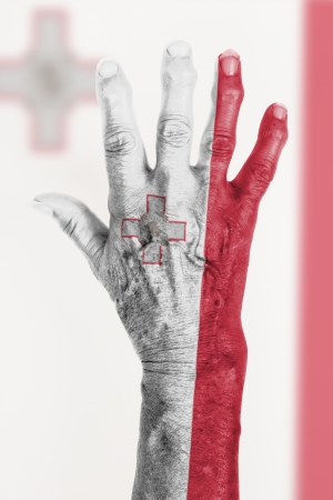 clipart wrinkles: Isolated old hand with flag, European Union, Malta Stock Photo