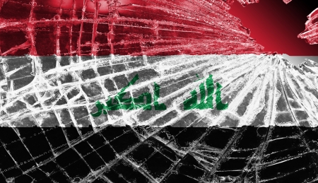 differential focus: Isolated broken glass or ice with a flag, Iraq Stock Photo
